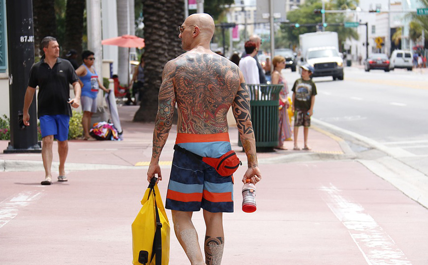 Bald man with tattoos
