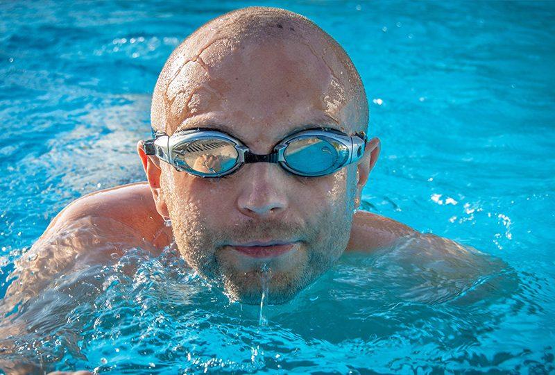 Bald man swimming