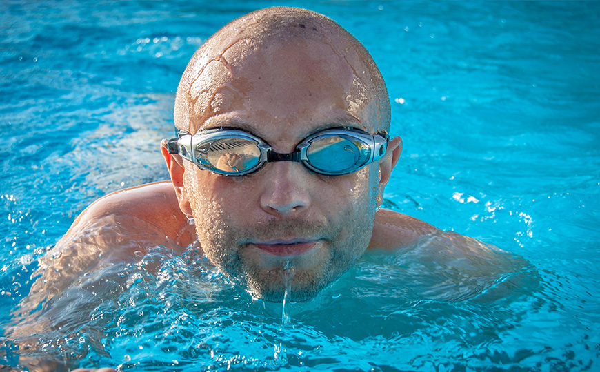 Bald man swimming