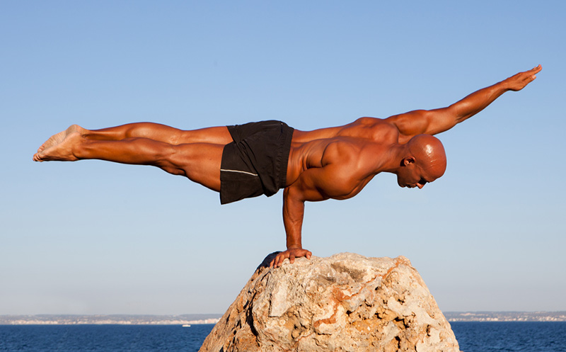 Healthy bald male with upper body strength